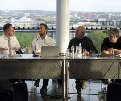 Panel of speakers at event
