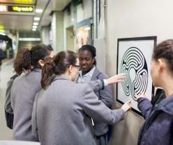 Students examining a Labyrinth