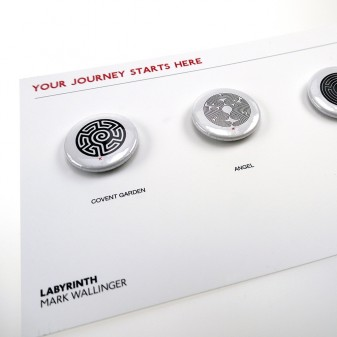 3 labyrinth pin badges on presentation board