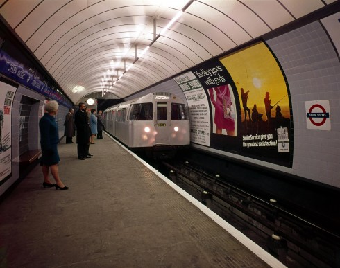 Seven Sisters Underground station platform, Victoria line. A Victoria-bound train of 1967-tube stock,  headed by driving motor car no.3143 draws into the station. A few (posed) passengers are waiting. A  seating recess with tiled motif can be seen in the foreground, 1969 Photograph Dr Heinz Zinram